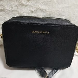Mk Monogram Cross body purse.